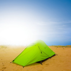 green touristic tent in a desert