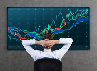 businessman looking on charts
