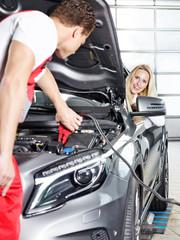 Mechanic helps customer
