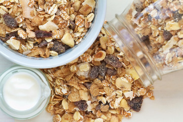 Muesli breakfast on a vintage wooden background