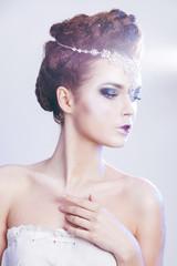 Beauty woman over blue winter background. Winter beauty woman