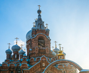 Church domes on a blue sky background.