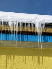 Icicles hanging on a roof