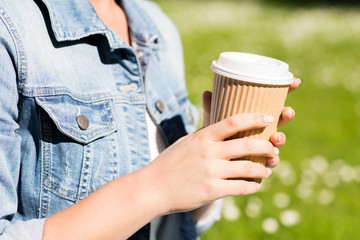 close up of young girl with coffee cup outdoors
