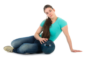 Beautiful woman sitting with a bowling ball, isolated on white