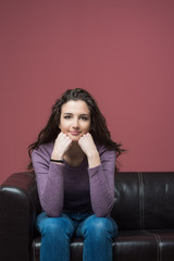 Happy girl sitting on sofa