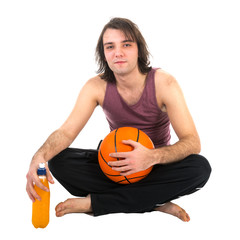 Man sitting on floor with basketball and orange juice