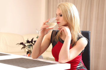 female drinking wine