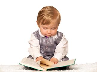 Bay boy reading a book
