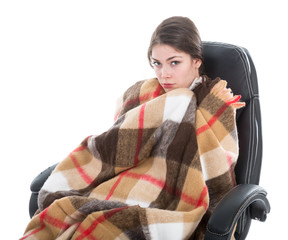 Woman with blanket sitting in armchair, isolated over white