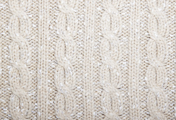 Braids pattern knit beige color with speckles.
