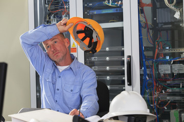 Electrical engineer taking a break in broadband control center