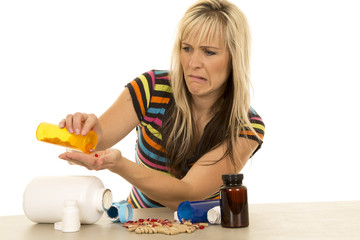 woman pouring pills into hand funny expression