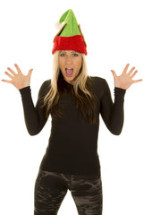 woman with elf hat hands out surprised