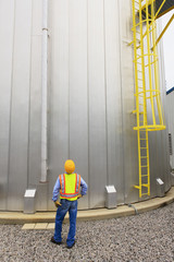 Engineer inspecting water storage tank