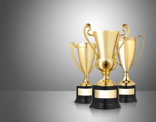 award golden trophies on gray background