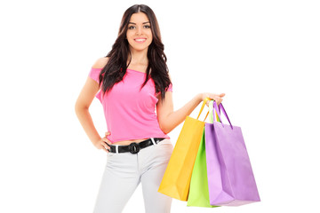Woman posing with shopping bags