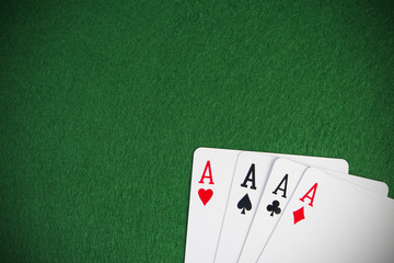 four aces high on green table