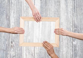Hands holding frame