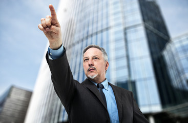 Businessman pointing his finger to determine the path