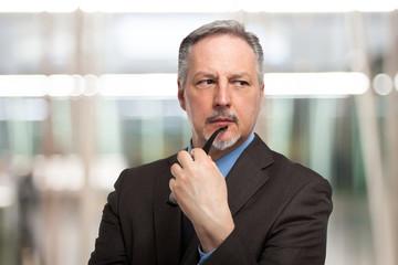 Pensive businessman portrait