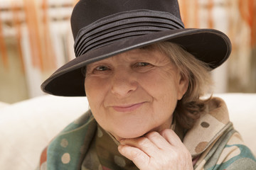 Beautiful chic senior woman in a hat