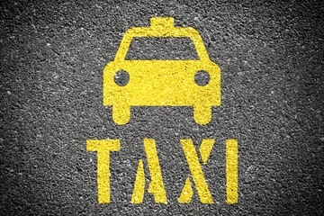Taxi Sign On The Asphalt