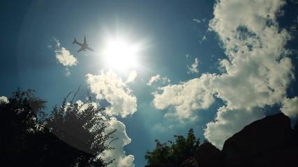 Plane Fying Through the Sun