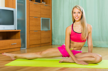Female doing yoga at home