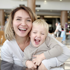 Portrait of happy mother with little son.