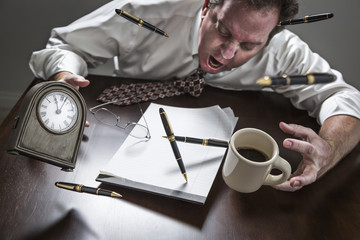 Stressed Man At Desk, Pens, Coffee, Glasses, Clock Flying Up