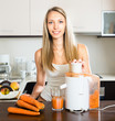 housewife making juice from carrots