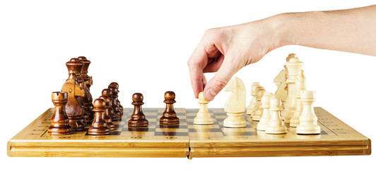 playing wooden chess on chess board