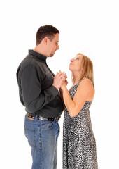 Husband and wife embracing.