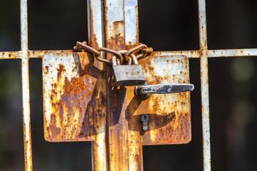 Iron chain with rusty padlock