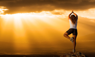 healthy woman  practice yoga at sunset