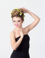 Beautiful woman with orchid flower in hair
