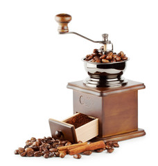 Wooden coffee grinder with beans and cinnamon