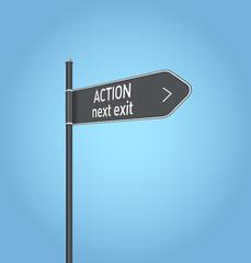 Action next exit, dark grey road sign