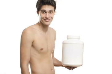 Skinny man training, drinking a protein shake, taking steroids