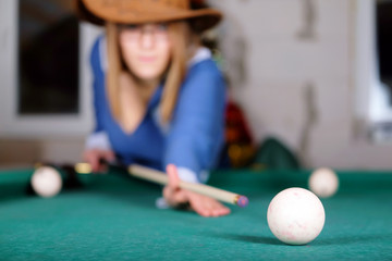 women are concentrated on a billiard ball number eight
