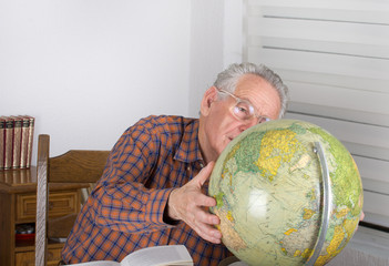 Old man with globe