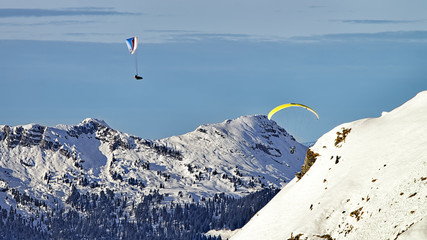 Two paragliders in swiss alps