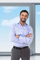 young attractive business man standing in corporate portrait