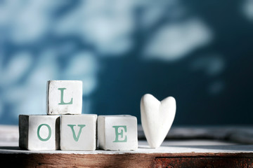 """Four cubes with """" LOVE """" words,background for valentine's day."""