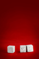 Three cubes with braille dots,background for valentine's day.