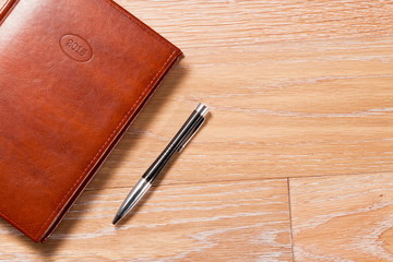 The daily log and the handle on a wooden background