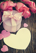 Pink roses, gift box and greeting card with copy space