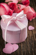 Bouquet of pink roses and gift box on wooden background