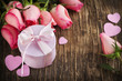 Bouquet of pink roses and gift box on wooden background with cop